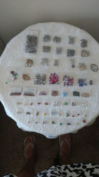 Assorted craft and jewelry making supplies. 56 assorted bags. FS