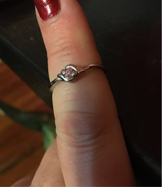 Silver toned ring with pink stone