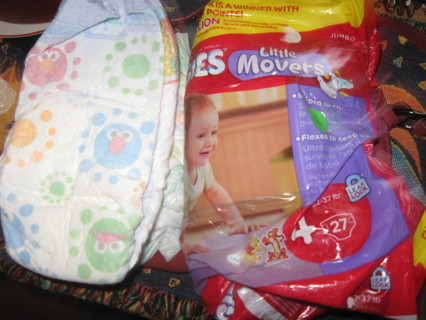 Size four diapers(4)Huggies 22-37 pounds