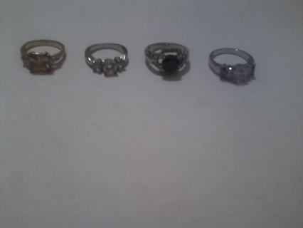 4 Very pretty costume rings and a watch