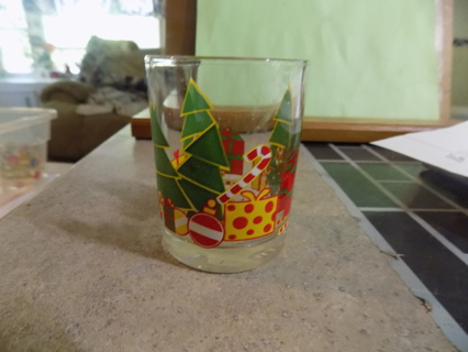 Christmas votive candle holder with trees and presents all around