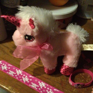 Pretty in pink girl bracelets and unicorn