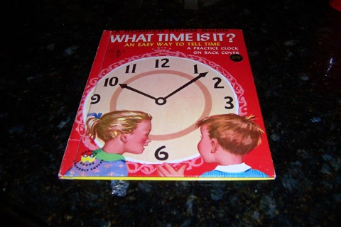 What Time is It? Practice Clock on Book Back 1954