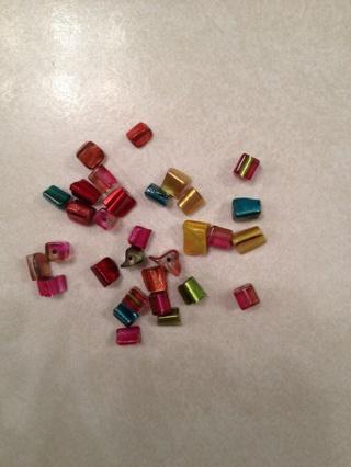 31 multi-colored unique glass beads
