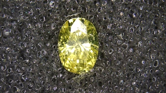DIAMOND CANARY YELLOW NATURAL OVAL SHAPE 15 POINTS A REAL BEAUTY AT A STEAL OF A DEAL PRICE.