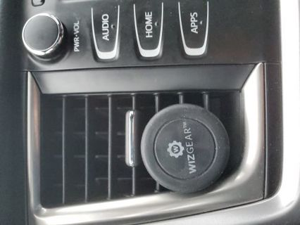 Phone magnetic holder in car by Wizgear