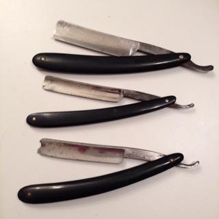 Three vintage straight razors