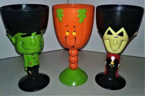"2003 3 hard plastic Halloween goblets: Frankenstein, Pumpkin & Dracula - 7"" tall x 3 1/2"" diameter"