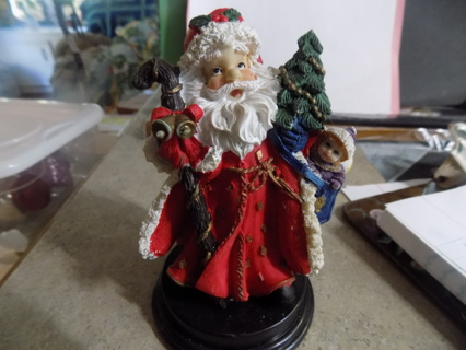 About 6 inch tall detailed Santa with cane, gold bells, small tree & toy bag