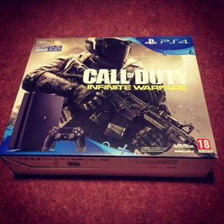 Brand New Sony PS4 Console Bundle 500GB w/Call of Duty: Infinite Warfare Disc & 1 other game