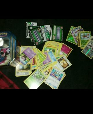 113 MINT CONDITION POKEMON CARDS (105 commons/uncommons with 8 HOLOS AND 8 ONLINE CODES)