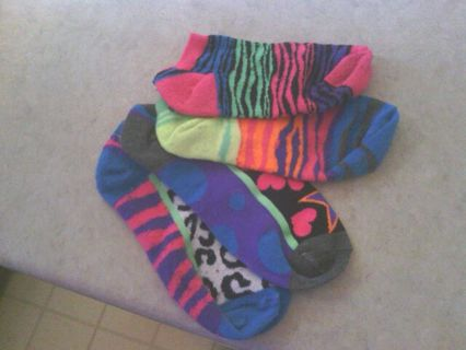 mitch matching neon socks with jergens ultra healing moisturizer as a gift
