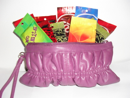 ~**10**~TANNING LOTIONS IN STUFFED PURSE!!!!!