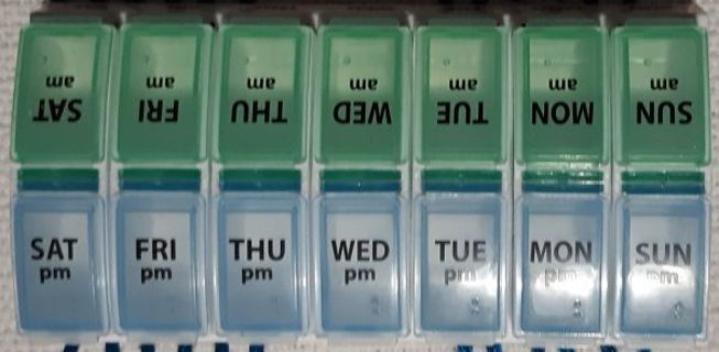 New Daily Pill Divider including: AM-PM/Sun. thru Sat. Color Coded Divider also with Braille