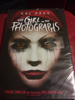 The girl in the photographs Factory sealed