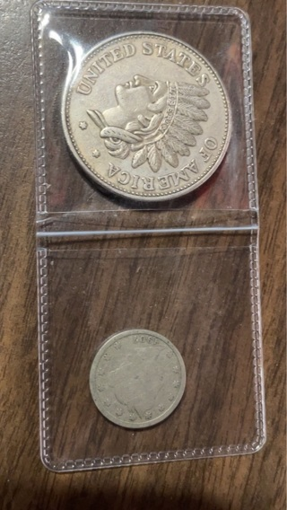 Old 5 cent coin and 1 old dollar coin