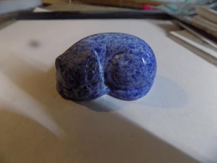 Ceramic blue paint splatter curled up sleeping cat