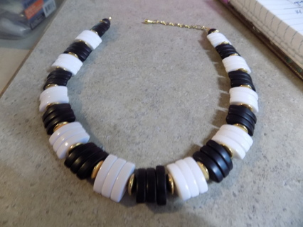 Black and white oval flat beaded necklace with round gold spacers