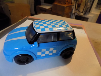 5 inch blue push car with checkerboard roof and door