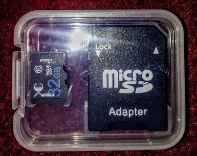 NEW! MICRO SD 32 GIG. & adapter.