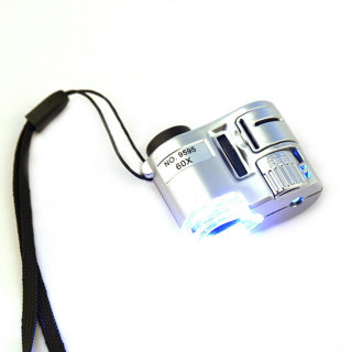 Mini Lens 60XPocket Magnifier Microscope With LED Ultraviolet Light Jewelry Jeweler Focus Adjustable
