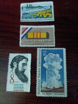 Four uncancelled used USA stamps