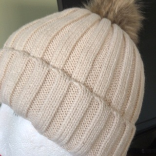 Beautifully Knitted Hat with a Pompom .