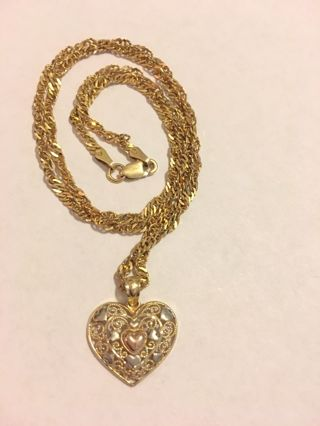 14kt Pendant And Chain 5.6 Grams