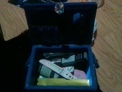 A blue sewing box with goodies
