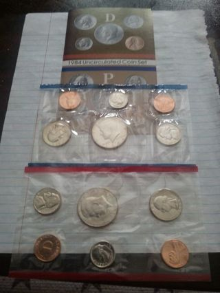 1984 P AND D UNCIRCULATED US MINT SET. IN ORIGINAL US GOVT PACKAGING.( NICE CLEAN SET)