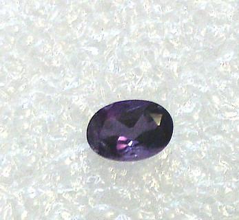 7mm by 5mm Oval Purple gemstone
