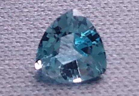 GEMSTONE NATURAL DEEP BLUE TOPAZ WITH A FATASTIC CUT TO IT 70 POINTS OF PURE BEAUTY.