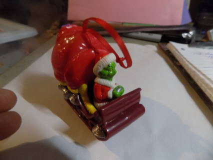 The Grinch in Santa's Sleigh plastic Christmas ornament