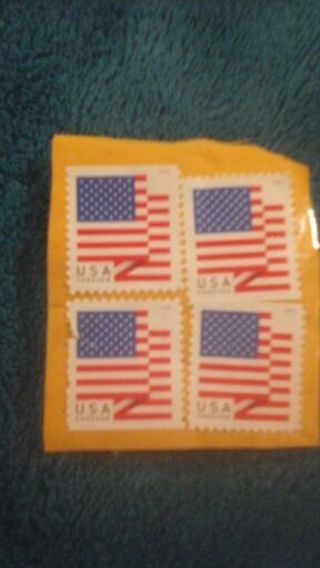 Four Unmarked Stamps