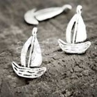 2 New silver sailboat charms Use get it now and get free surprise