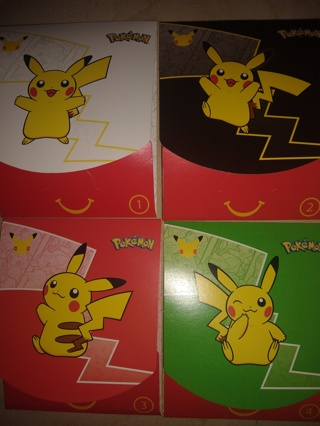 Unopened sealed Mcdonalds 4 packs with outer envelope and goodies Pokemon trading cards