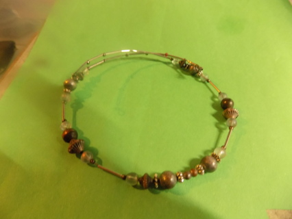Silvertone wire choker necklace with clear round glass beads, brown lantern beads and brass beads