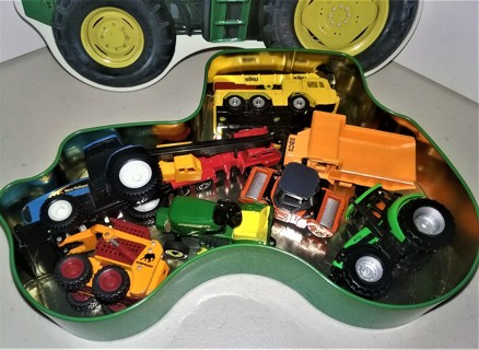 """8 plastic toy land/farm vehicles in tractor-shaped tin - 9"""" X 6"""" - VG collectible condition"""