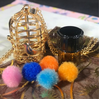Golden bird cage Aromatherapy necklace w/bag, 5 pompoms & 1 dram of Essential oil of choice