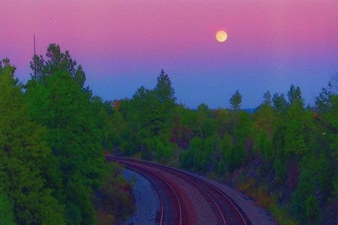 Sunset and Moon Raising over the train tracks