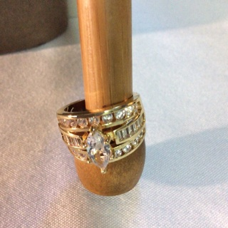 Size 7 Gold Tone  Ring with Stones .