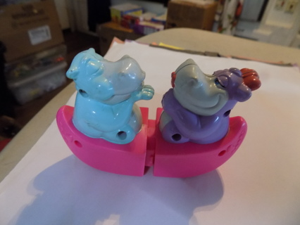 vintage McDonalds toy?  Two hippos in pink canoe