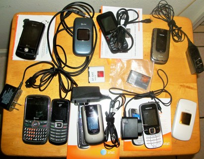 LOT OF 9 CELL PHONES WITH CORDS, XTRA BATTERIES AND INSTRUCTIONS