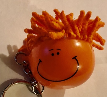 """Brand New Orange, Yarn Haired """"IMPRINT"""" Smiley Faced Keychain. Free To Ship"""