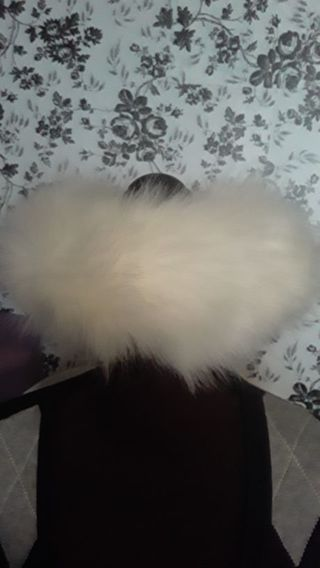 White rich looking fluffy winter hat