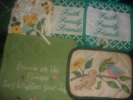 FIVE ASSORTED POT HOLDERS - SLIGHTLY USED