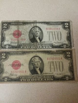 2 1928 red seal 2 dollar bills