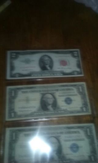 $2.00 red seal and silver certificates