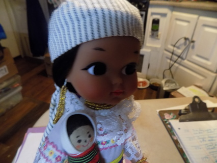 11 inch tall Mother with her baby doll dressed in her Native Costume with jewelry