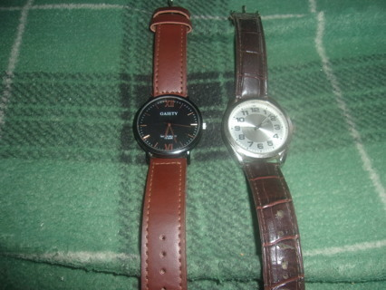 TWO SLIGHTLY USED MEN'S WATCHES